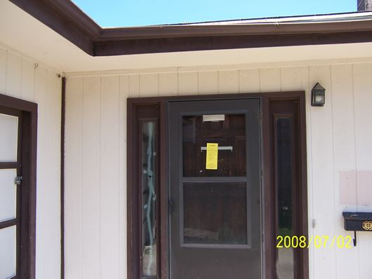 Yellow Tag on House