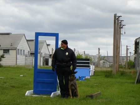 Officer Chris Goley and Kai at an Obstacle Course